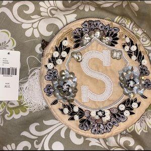 """Anthropologie """"S"""" monogram crest pouch"""